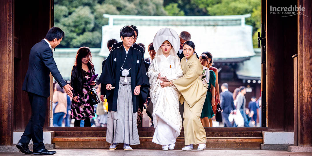 Bride and groom at traditional Shinto wedding ceremony at Meiji Shrine